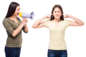 Mom using megaphone to yell at her teen daughter, the opposite of calm parenting