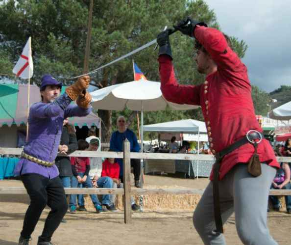 Program coaches Scott Farrell (left) and Kyle Lazzarevich demonstrate the medieval art of fencing with the German longsword at the 2015 Tournament of the Phoenix in Poway, CA